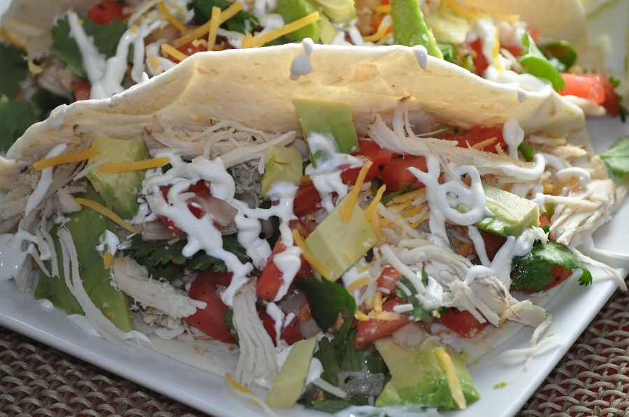 Crockpot Chicken Tacos Drizzeled with Sour Cream