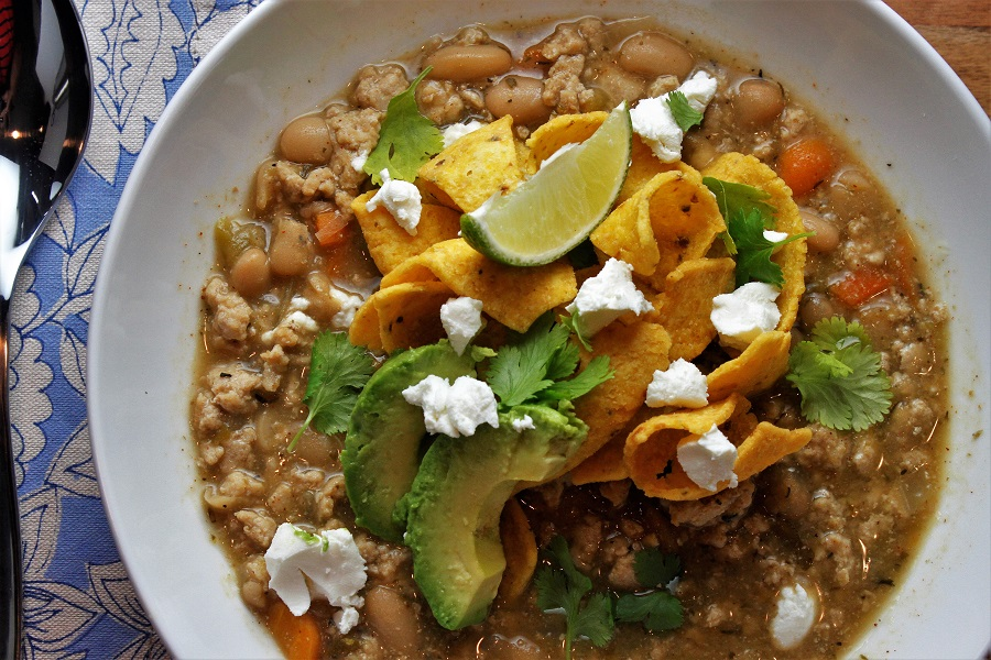 Crockpot Ground Chicken Chili Recipe Bowl of Chili with Avocado and Chips