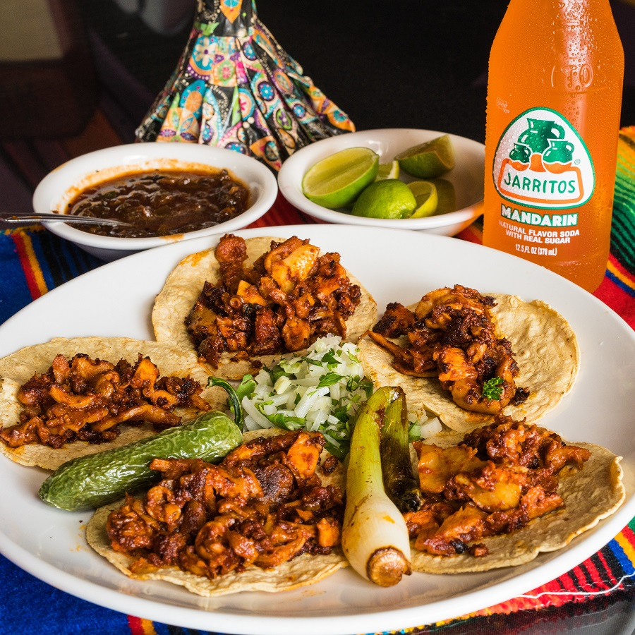 Crockpot Pantry Meals Plate of Tacos with Drink in the Background