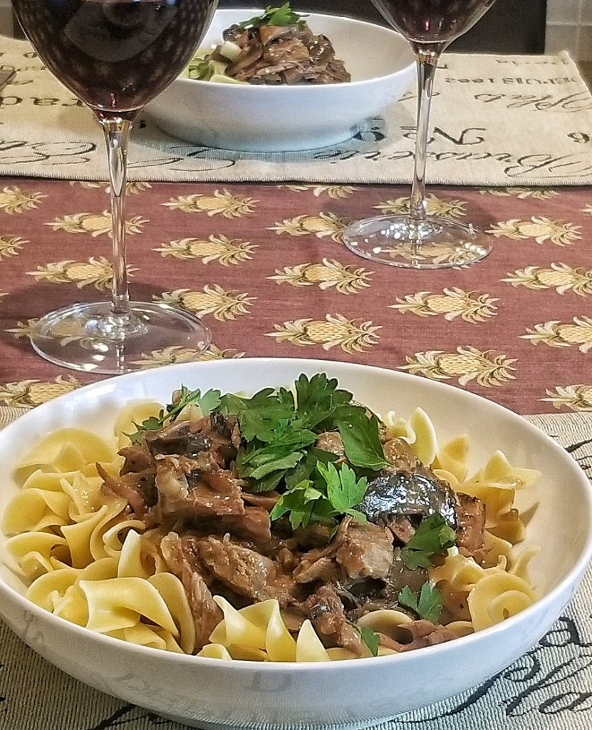 Dairy Free Slow Cooker Beef Stroganoff Bowl of Stroganoff with a Glass of Wine