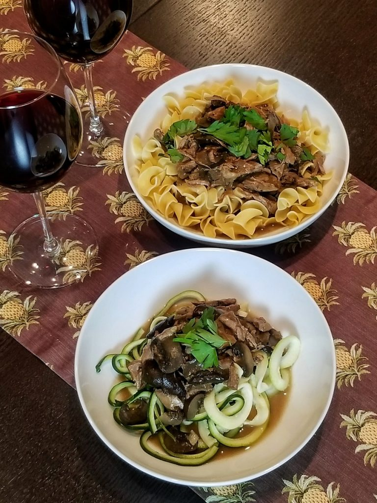 Dairy Free Slow Cooker Beef Stroganoff Overhead View of Stroganoff on a PLate of Zoodles and a Plate of Pasta