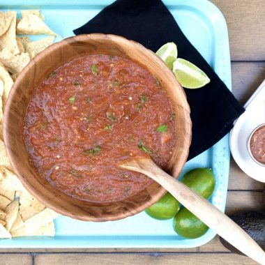 Homemade Slow Cooker Salsa in a Bowl with Chips and Limes