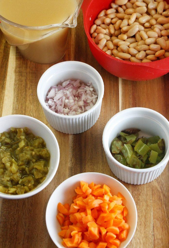 Crockpot Ground Chicken Chili Recipe Ingredients Organized on Table