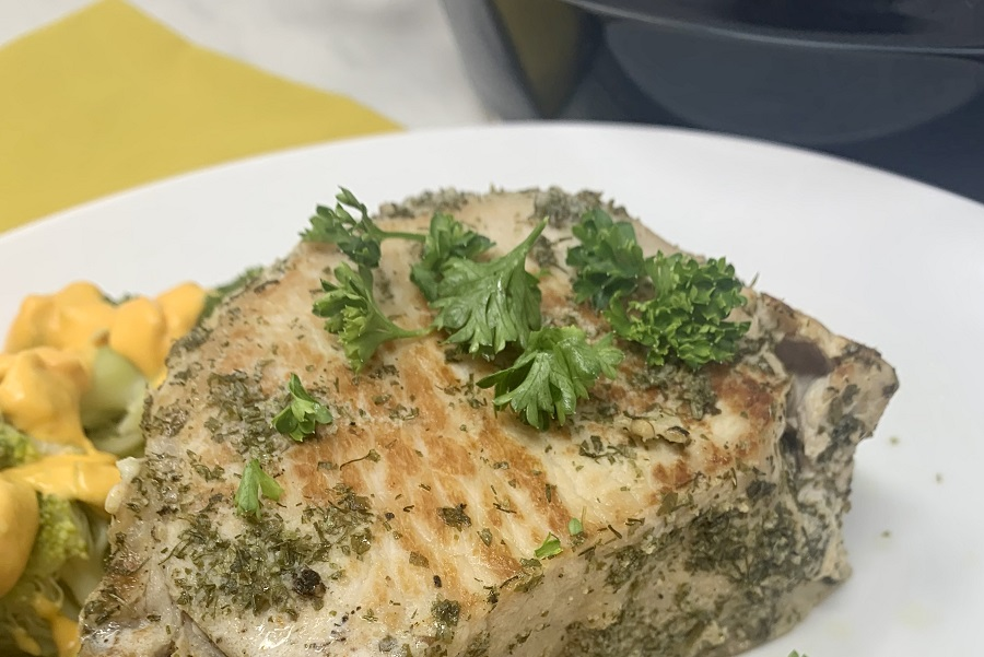 Low Carb Instant Pot Pork Chops Recipe Pork Chops on a Plate in Front of an Instant Pot