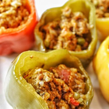 Low Carb Slow Cooker Stuffed Peppers Assorted Stuffed Peppers on a Plate