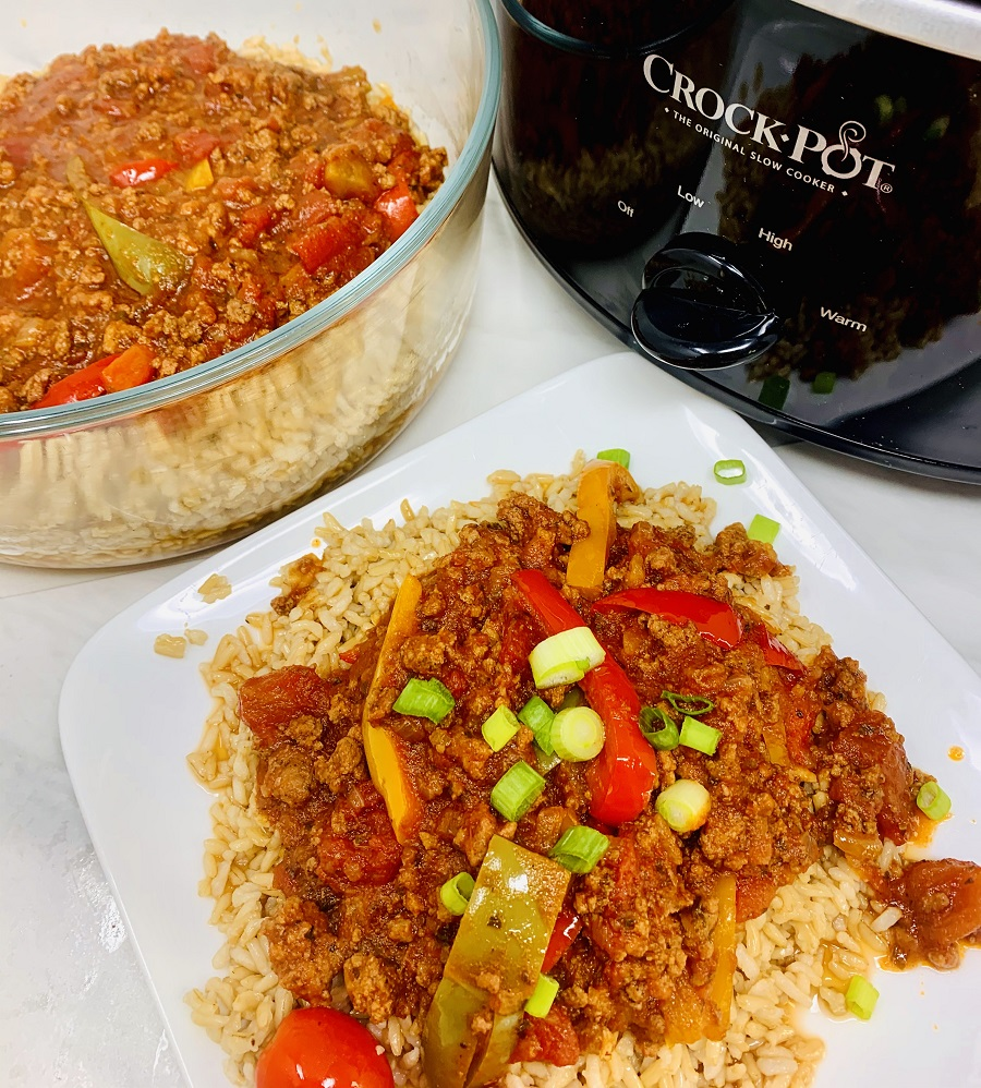 Crockpot Beef with Brown Rice and Vegetables Overhead View of a Plat, Bowl, and Crockpot Filled with Beef Mixture