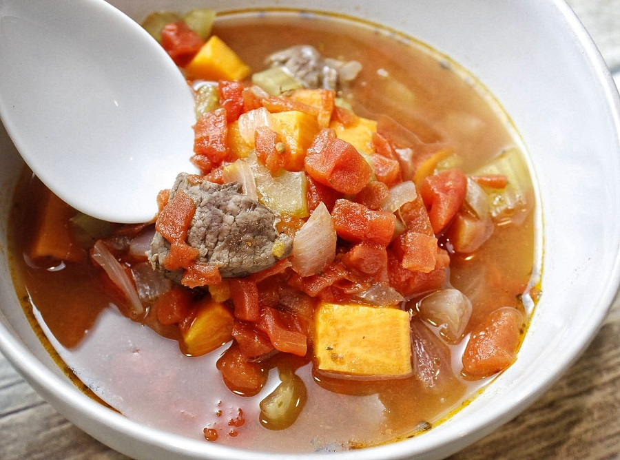 Healthy Instant Pot Vegetable Beef Soup Ingredients Overhead View of Soup in a Bowl With a White Spoon