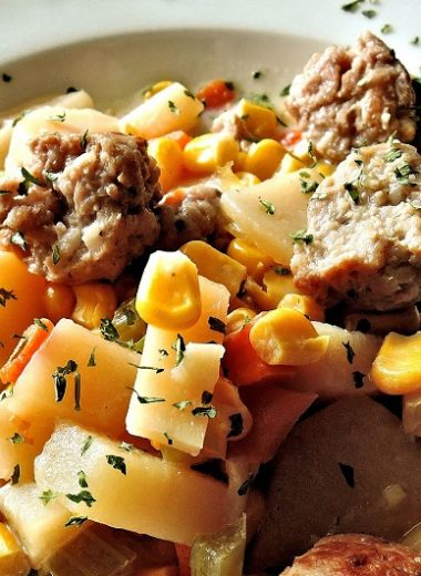 Instant Pot Sausage and Potatoes Recipes A White Bowl Filled with Sausage and Potatoes