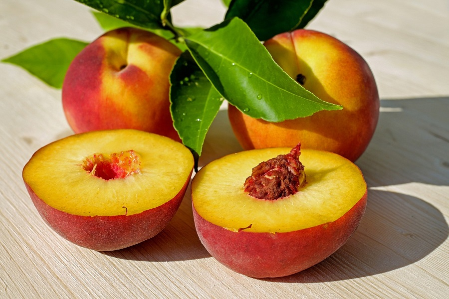 Slow Cooker Peach Cobbler Recipes Close Up of Two Peaches Cut in Half