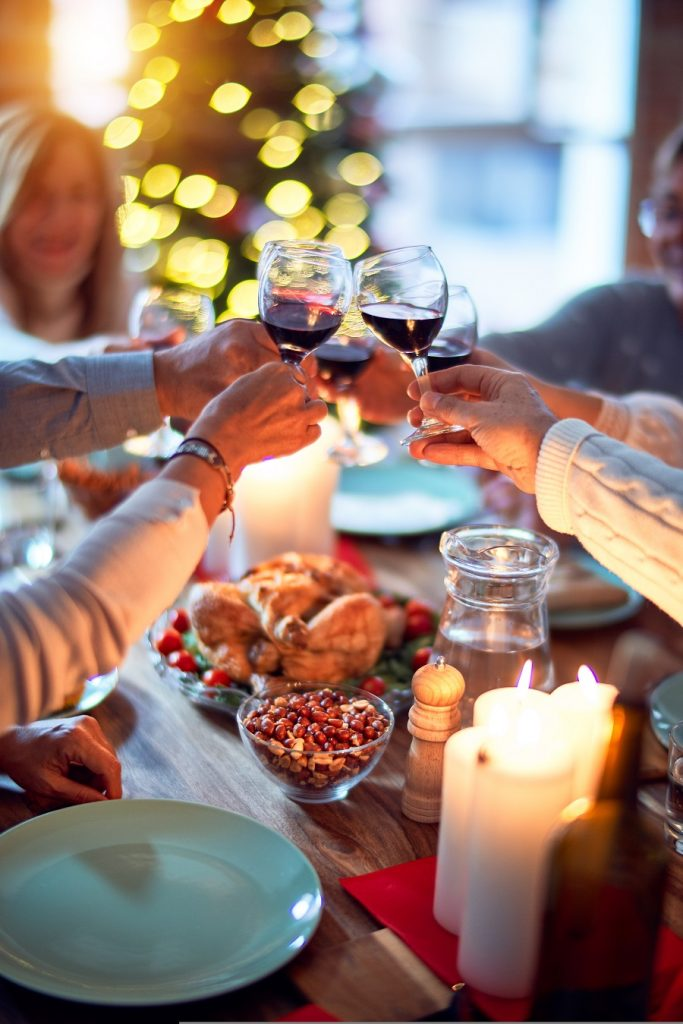 Instant Pot Holiday Side Dishes People Clinking Wine Glasses Together Above a Holiday Table