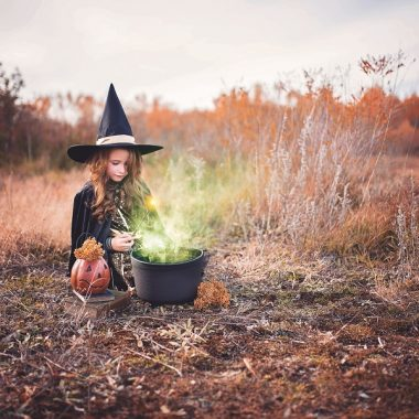 Crockpot Halloween Recipes Little Girl Dressed as a Witch Making a Brew in a Field