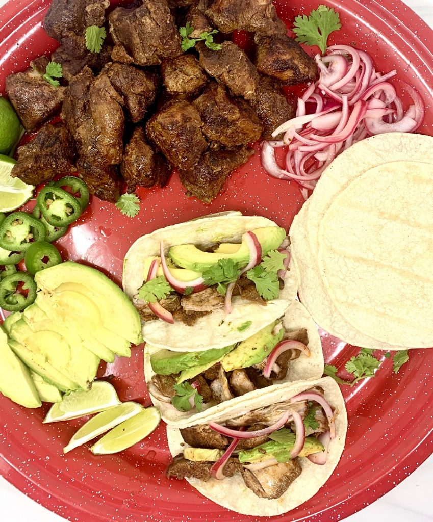 Crockpot Pulled Pork Tacos Recipe Overhead View of Pork Tacos on a Red Plate