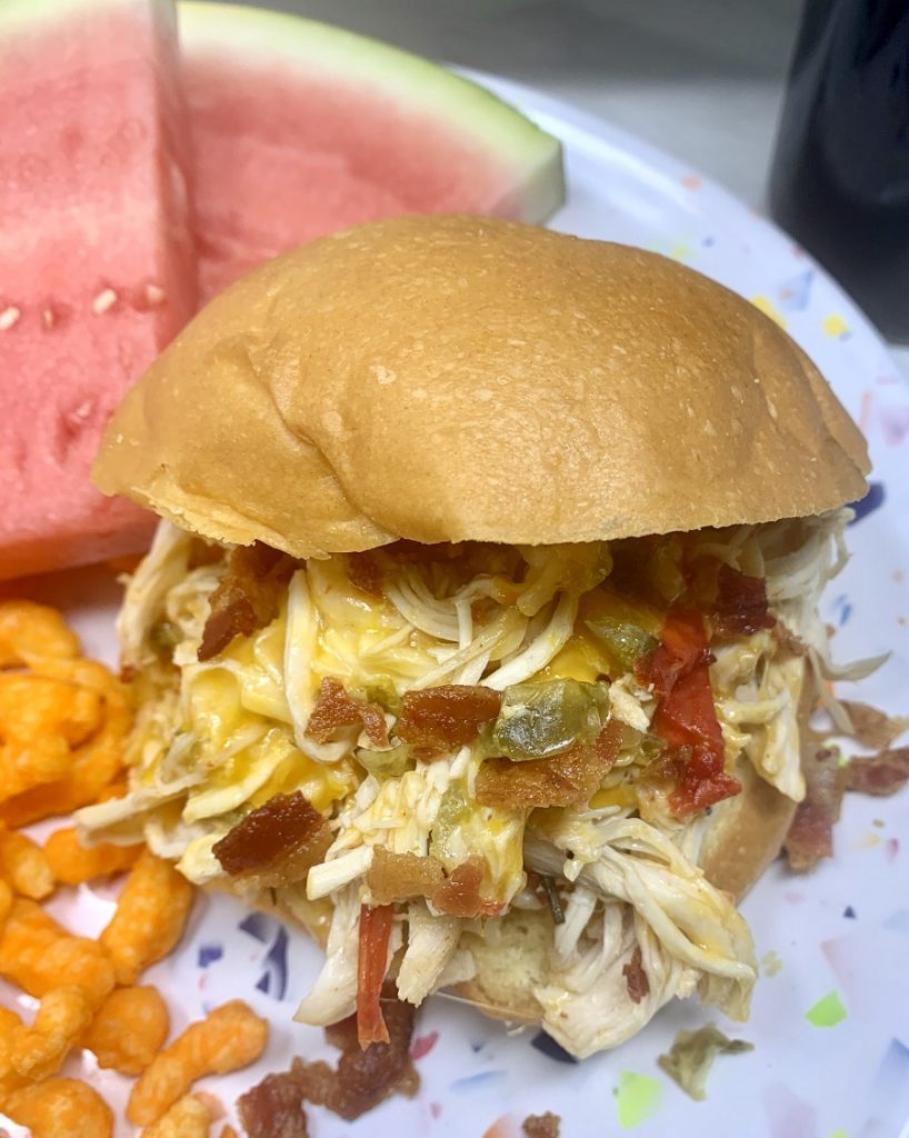 Crockpot Shredded Chicken Sandwiches Sandwich on a Plate with Watermelon Slices