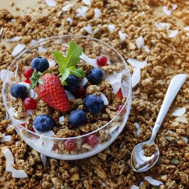 Crock Pot Granola Recipes a Bowl of Granola Sitting on A Table Covered in Granola
