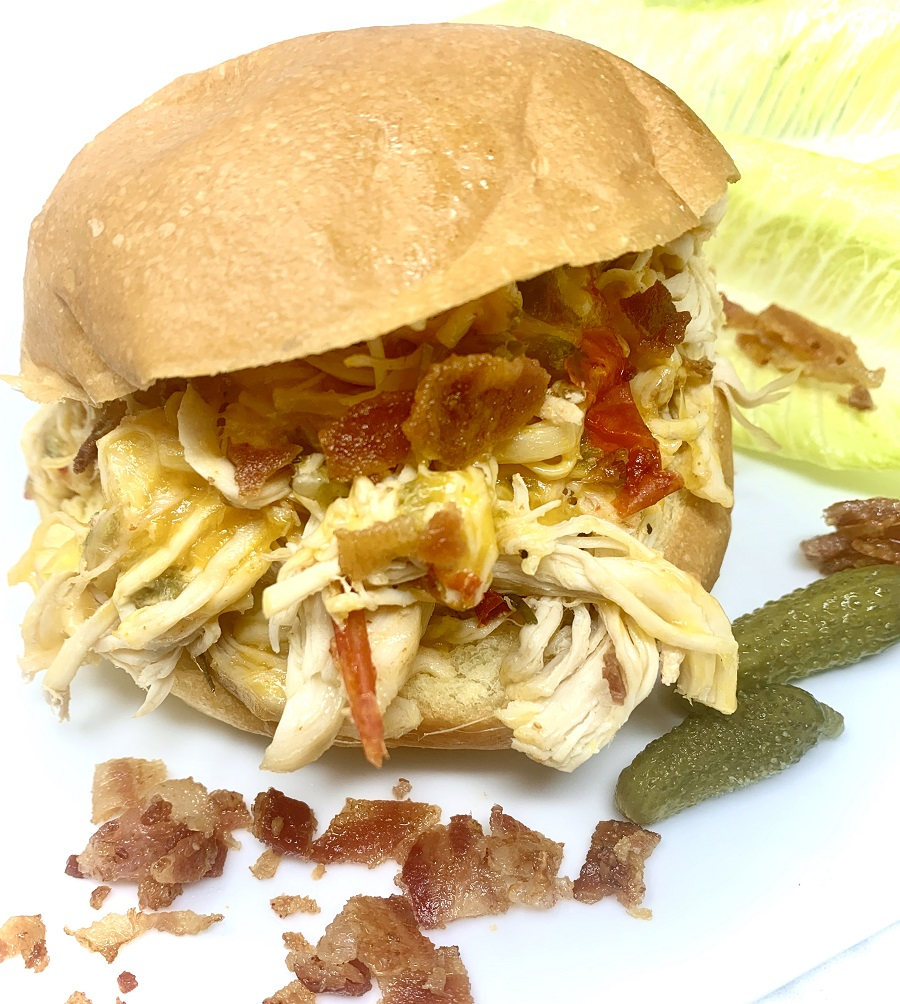 Crockpot Shredded Chicken Sandwiches Finished Sandwich on a Plate with Bacon Crumbles
