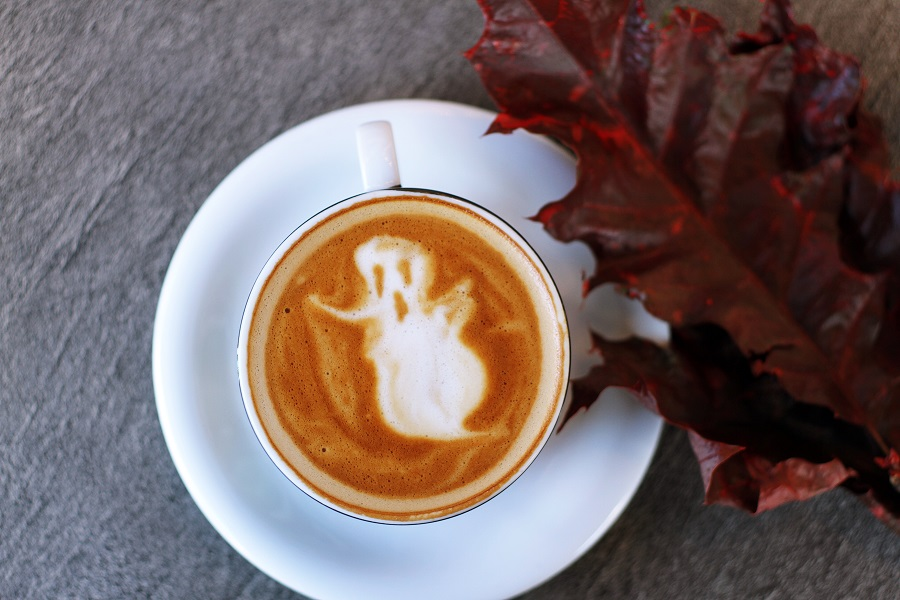 Halloween Slow Cooker Cider a Cup of Coffee with a Ghost in the Foam