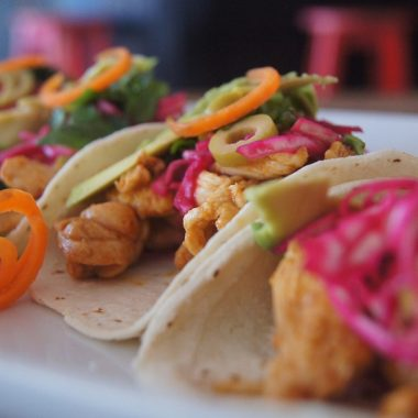 Slow Cooker Chicken Taco Recipes Close Up of Tacos on a White Plate