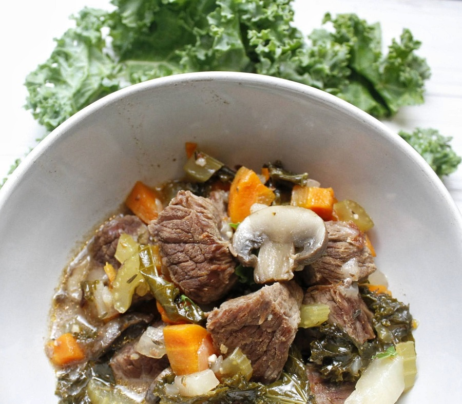 Healthy Slow Cooker Beef Stew Overhead View of a Bowl of Stew with Greens Next to It