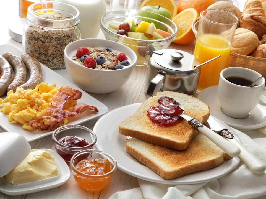 Crockpot Breakfast Ideas a Breakfast Spread with A Glass of Juice