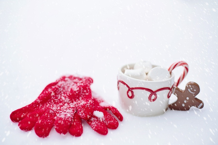 Crockpot Spiked Hot Chocolate Recipes a Cup of Hot Chocolate in the Snow with a Pair of Red Gloves Next to it
