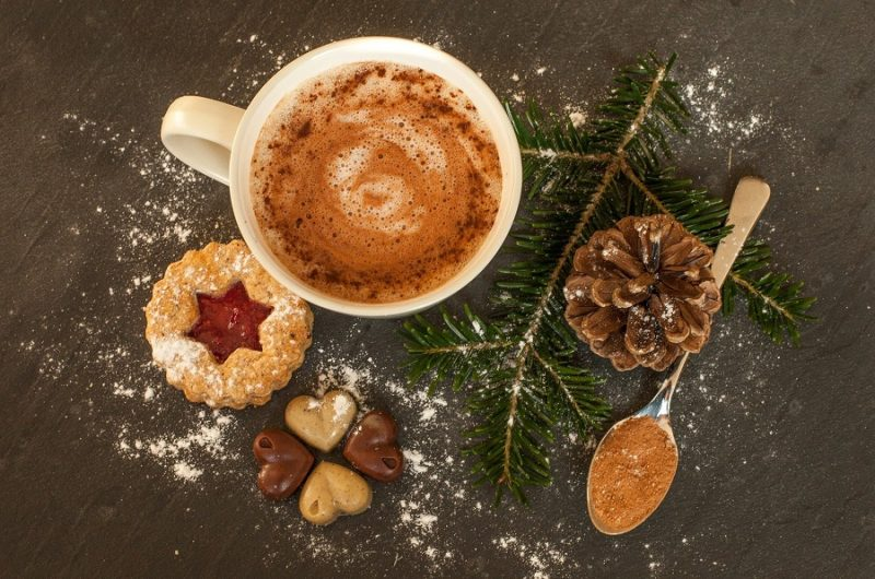 Crockpot Spiked Hot Chocolate Recipes Overhead View of a Cup of Hot Chocolate Surrounded by Pine Cones, Pines, and Cookies
