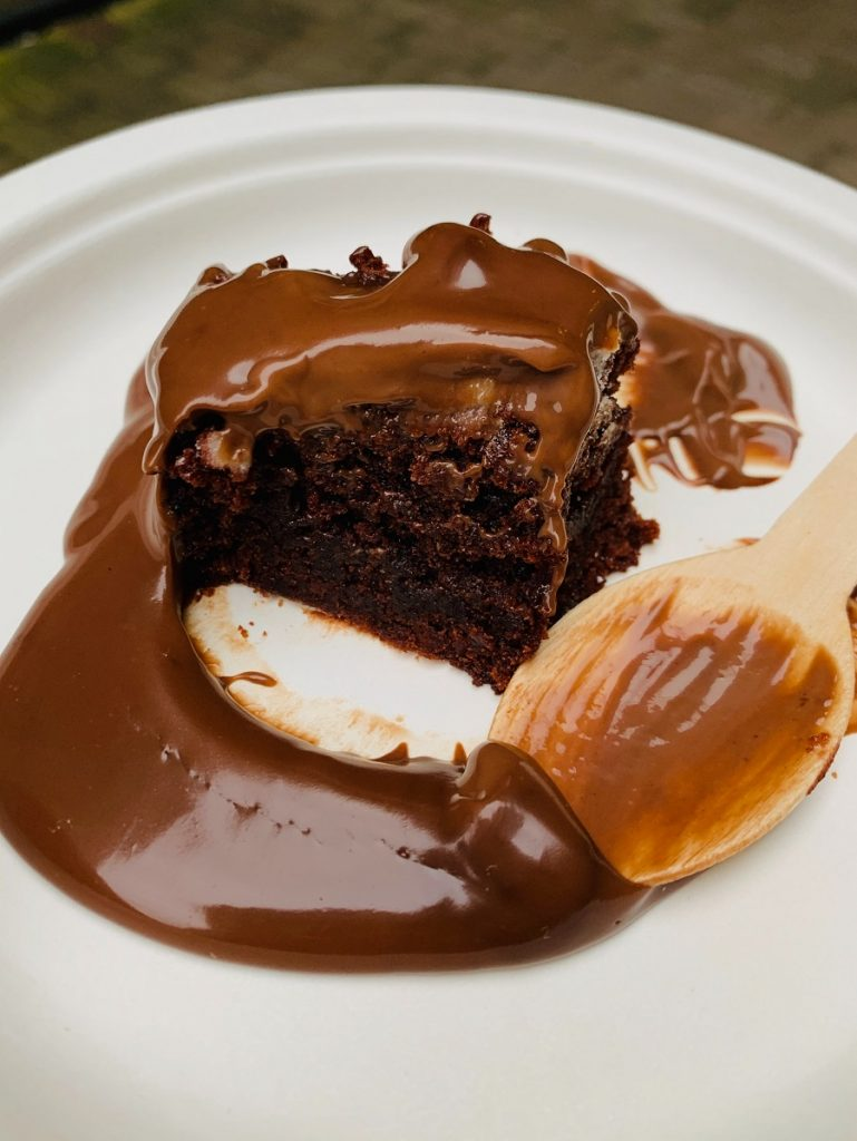 Instant Pot Desserts for a Crowd a Slice of Cake Covered in Caramel Sauce