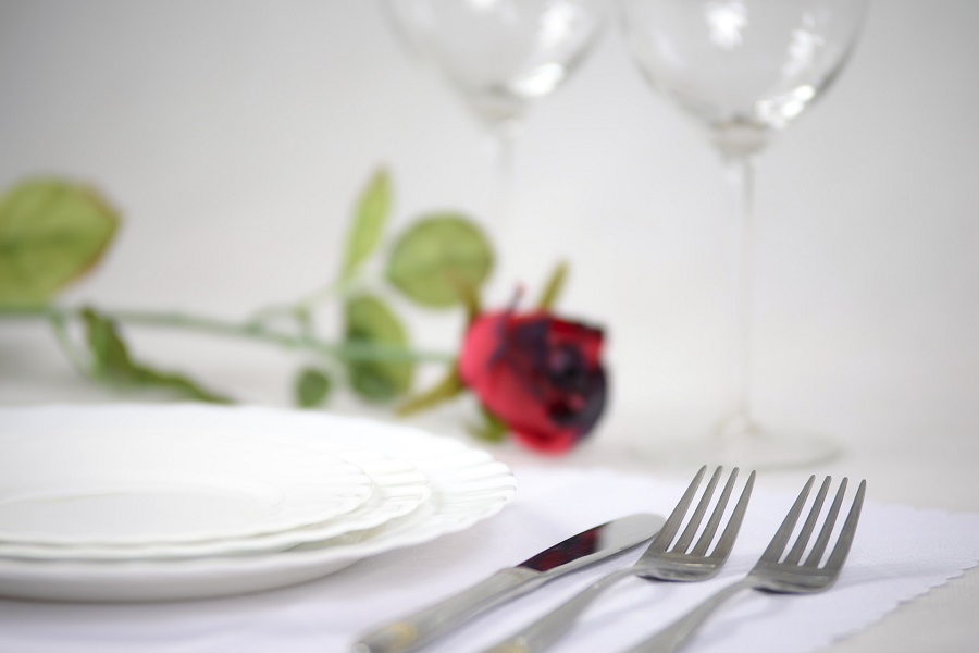 Crockpot Valentine's Day Recipes Table Setting with a Rose in the Background