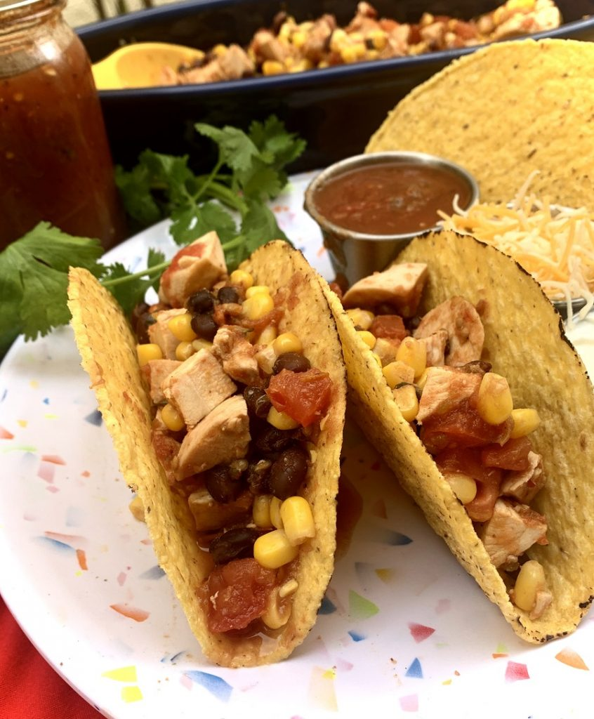 Easy Slow Cooker Salsa Chicken for Tacos a Couple of Tacos on a White Plate