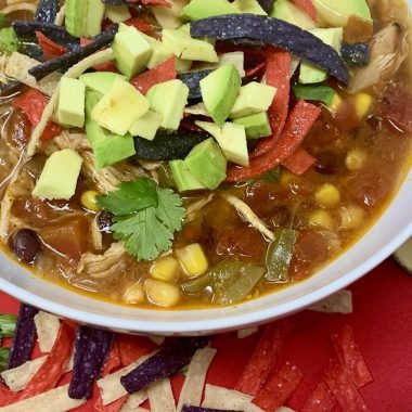 Slow Cooker Creamy Chicken Tortilla Soup Recipes Close up of a White Bowl Filled with Soup