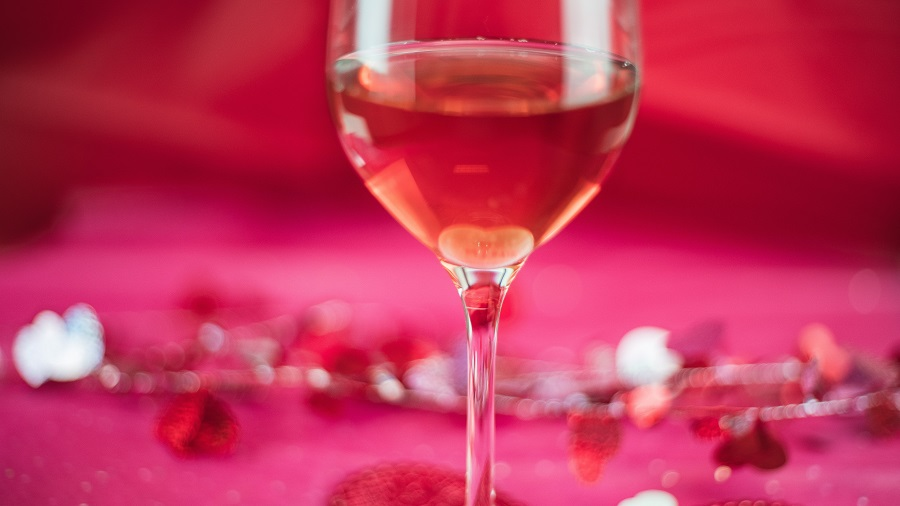 Instant Pot Valentine's Day Recipes a Glass of Wine with Roses in the Background