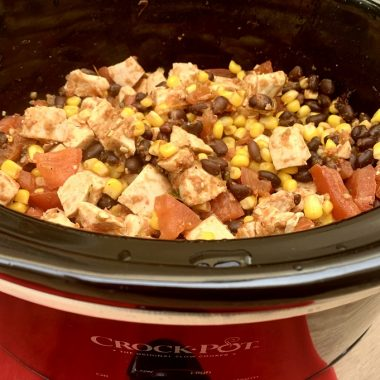 Easy Slow Cooker Salsa Chicken for Tacos Cooking in a Crockpot