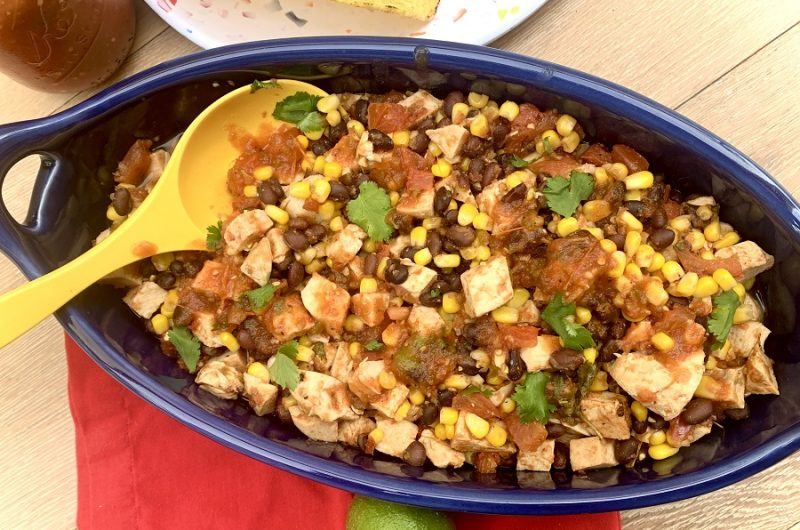 Slow Cooker Salsa Chicken for Tacos Overhead View of Chicken Cooking in a Crockpot