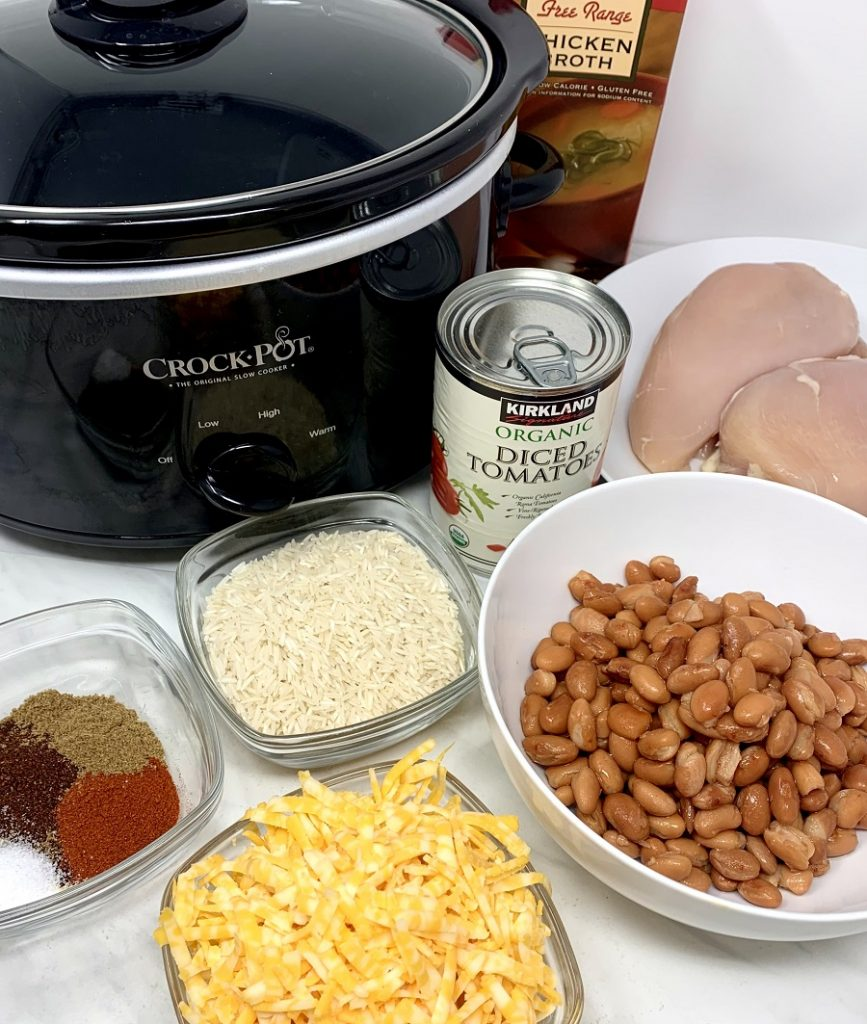 Crockpot Chicken and Rice Burrito Bowl Recipe Ingredients Gathered Together Next to a Crockpot