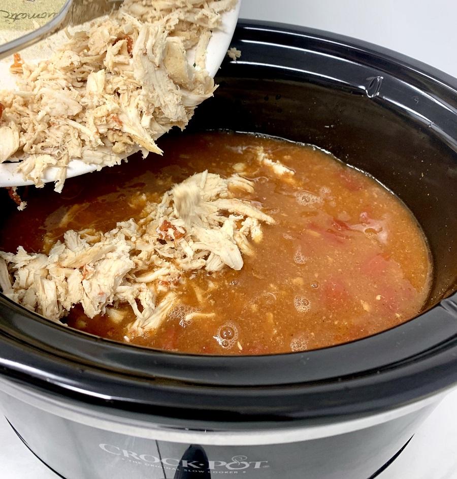 Crockpot Chicken and Rice Burrito Bowl Recipe Person Pouring Chicken into a Crockpot