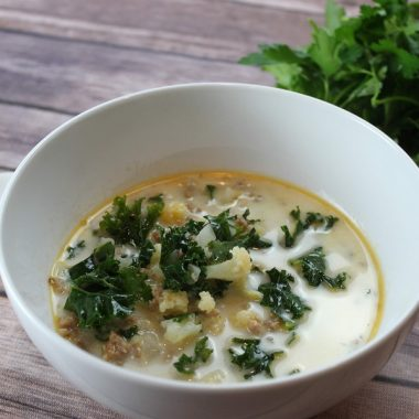 Instant Pot Kale Soup with Sausage Recipes a Bowl of Soup with Kale Next to it and a Soup Spoon in the Background