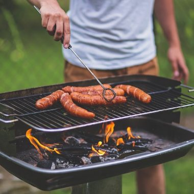 Instant Pot Outdoor BBQ Recipes Man Cooking Links on a Small Rectangle Grill