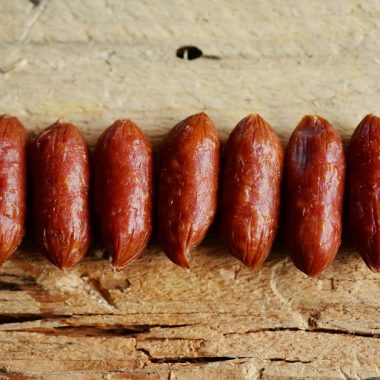 Crockpot Little Smokies with Brown Sugar Recipes Finished Sausages in a Row on a Wooden Surface