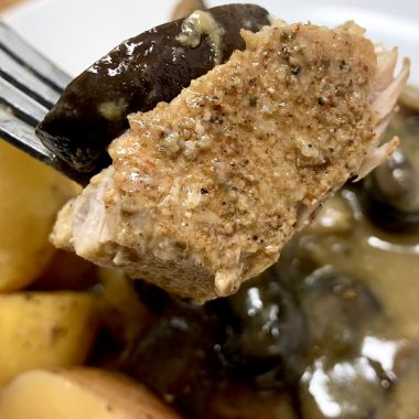 Crockpot Pork Chops with Cream of Mushroom Soup Recipe Close Up of a Piece of Pork Chop on a Fork