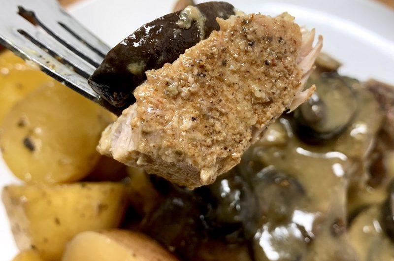 Crockpot Pork Chops with Cream of Mushroom Soup Recipe Close Up of a Piece of Pork Chop on a Fork