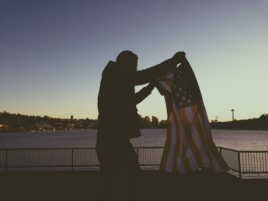 Instant Pot Memorial Day Recipes Man Folding a Flag in Front of a Field