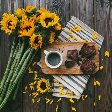 Instant Pot Brownie Desserts Overhead View of Brownies on a Plate with Coffee and Sun Flowers Next to Them
