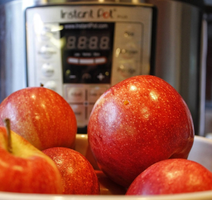 Close Up of Raw Apples in Front of an Instant Pot
