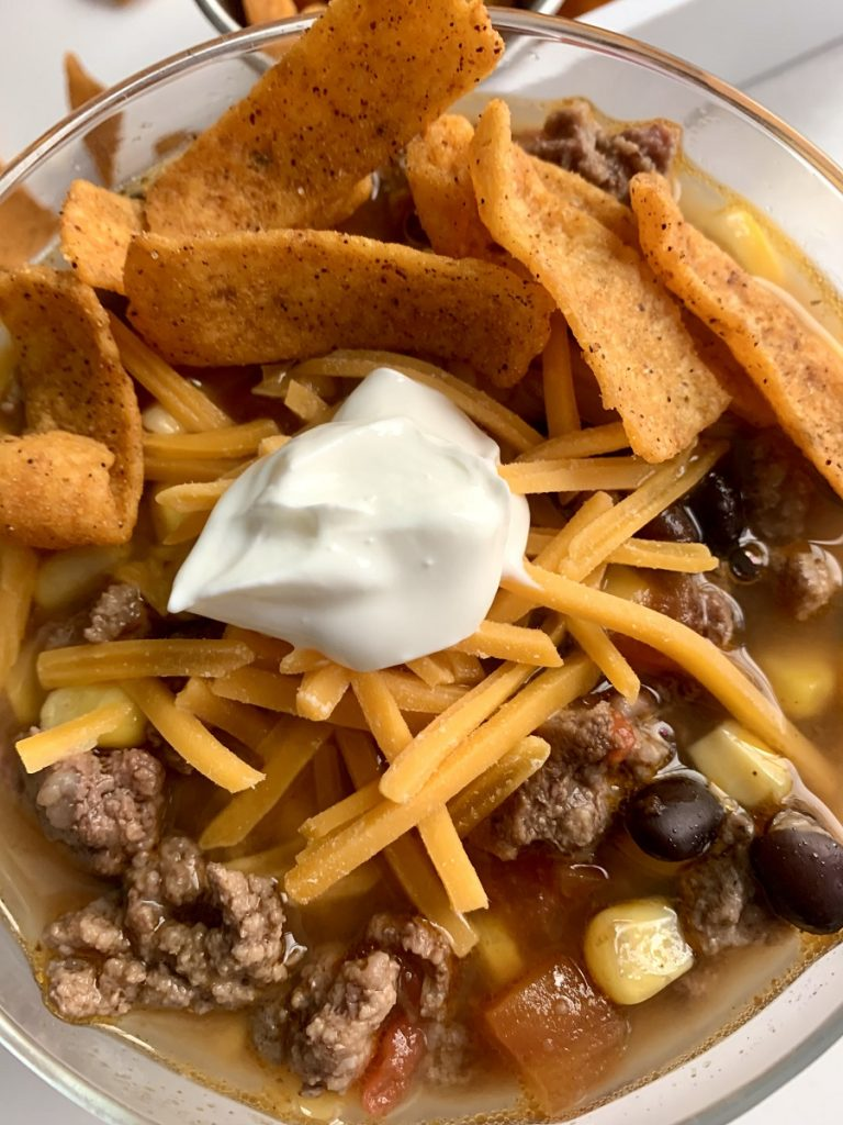 Crockpot Taco Soup Recipe with Beans Close Up of a Bowl of Soup with Garnishes