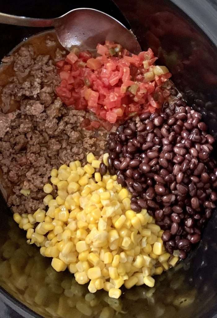 Crockpot Taco Soup Recipe with Beans Overhead View of a Crockpot with Ingredients Inside