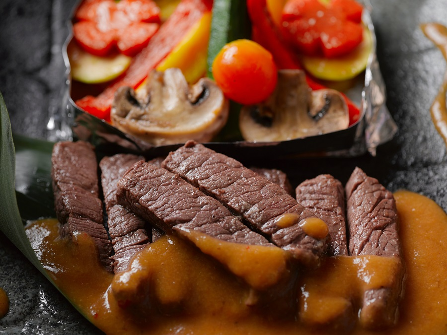 Healthy Crockpot Freezer Meals with Beef Overhead View of Beef Strips with Vegetables in Foil Next to The Beef