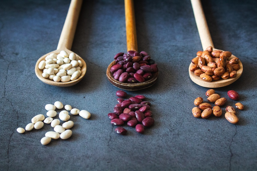 Instant Pot Tips for Cooking Beans Three Wooden Spoons Each Filled with a Different Type of Bean