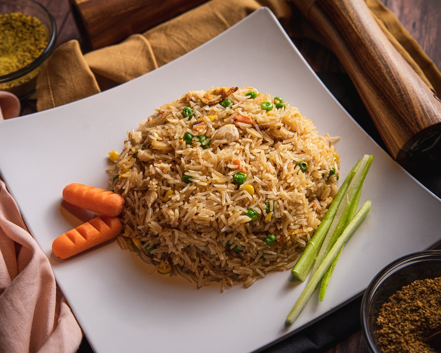 Instant Pot Tips for Cooking Rice a Plate of Fried Rice with Carrots and Green Onions