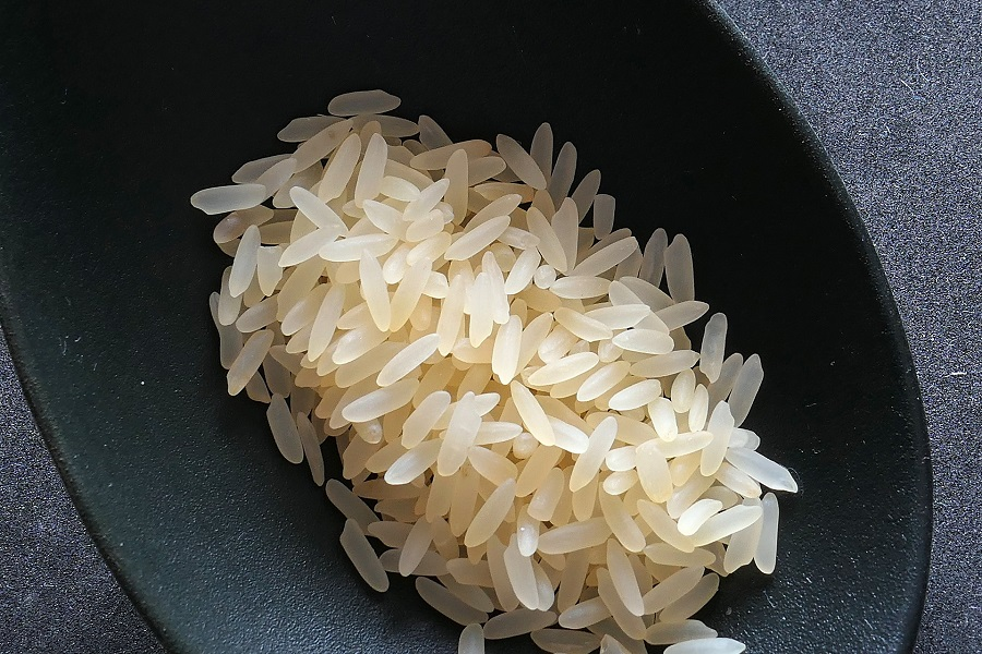 Instant Pot Tips for Cooking Rice Small Bowl of Uncooked White Rice