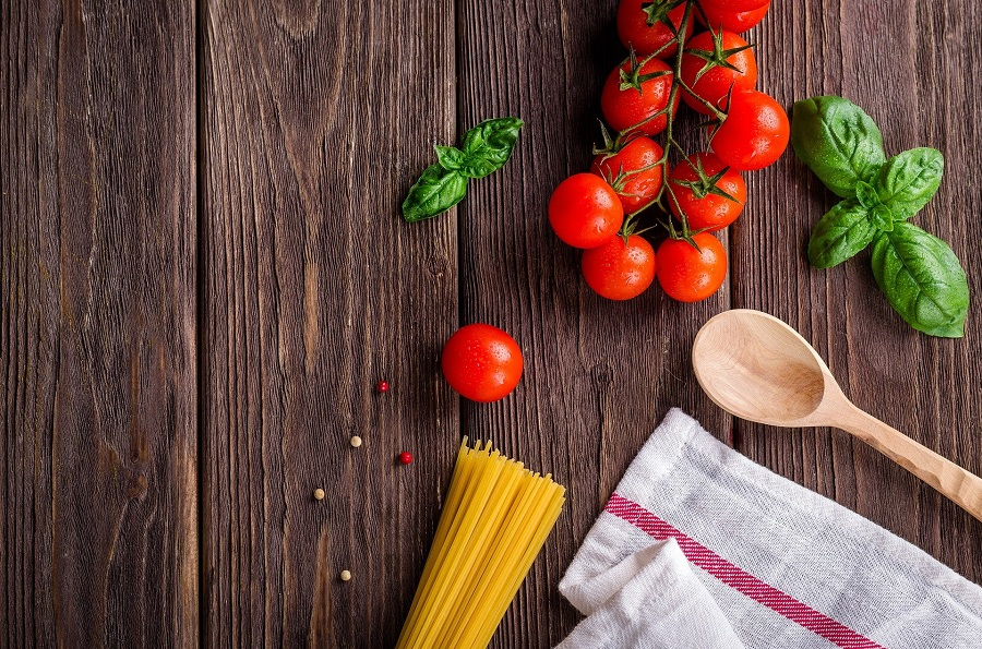 Instant Pot Pasta Recipes Overhead View of Pasta Ingredients on a Wooden Surface