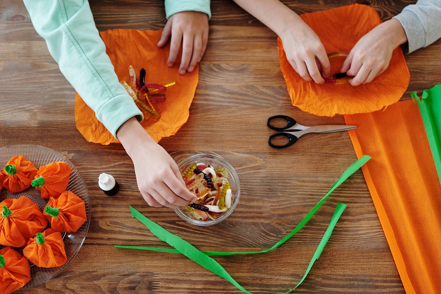 Instant Pot Halloween Recipes Overhead View of People Making Halloween Treat Bags